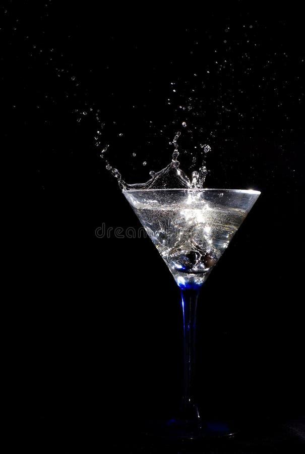 El salpicar del alcohol fotos de archivo