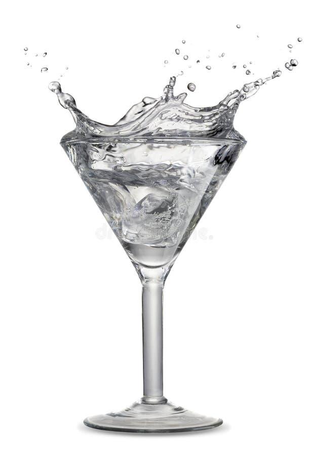 El salpicar en el vidrio de martini imagen de archivo libre de regalías