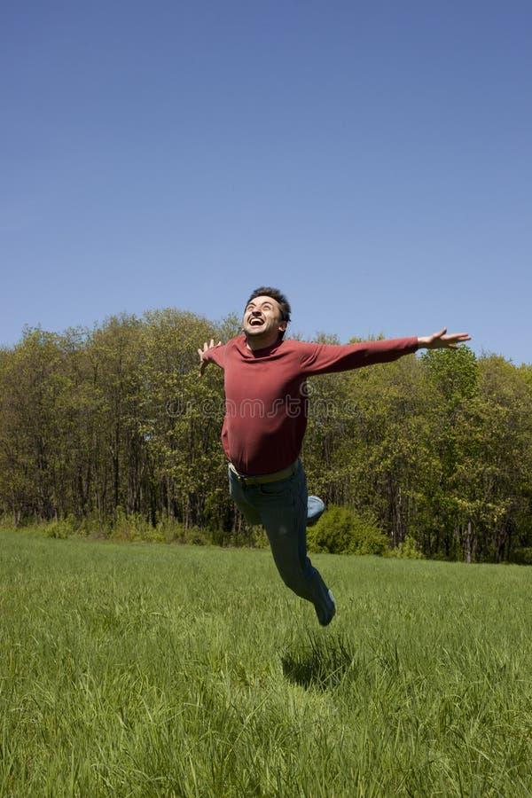 El salto del hombre fotografía de archivo libre de regalías