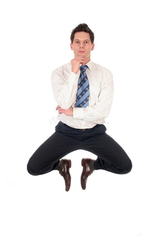 El salto del hombre de negocios fotos de archivo