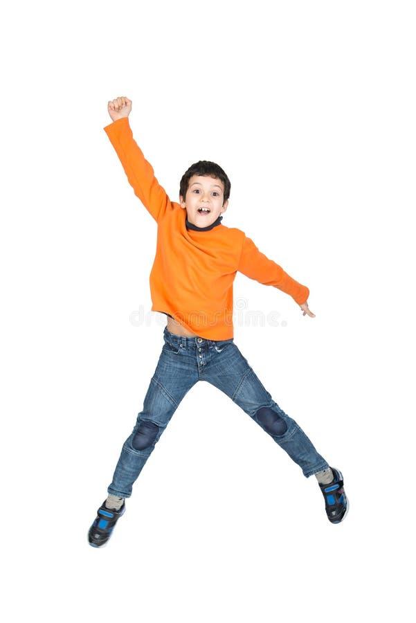 El salto del muchacho aislado en blanco fotos de archivo