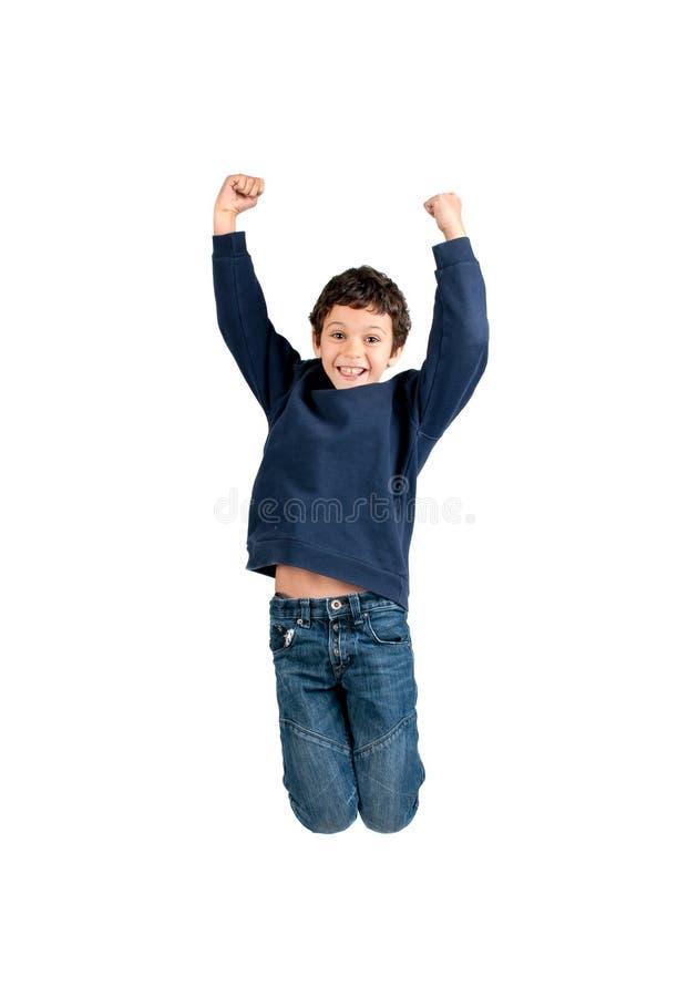 El salto del muchacho aislado en blanco imagen de archivo