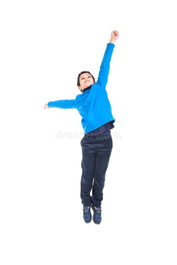 El salto del muchacho aislado en blanco foto de archivo libre de regalías