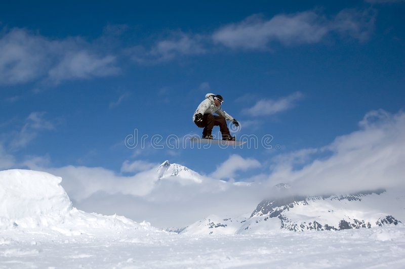 El salto del Snowboarder imágenes de archivo libres de regalías