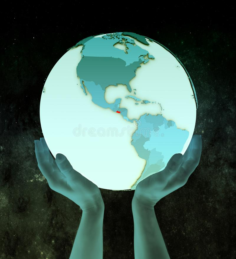 El Salvador auf blauer Kugel in den Händen lizenzfreie stockfotografie