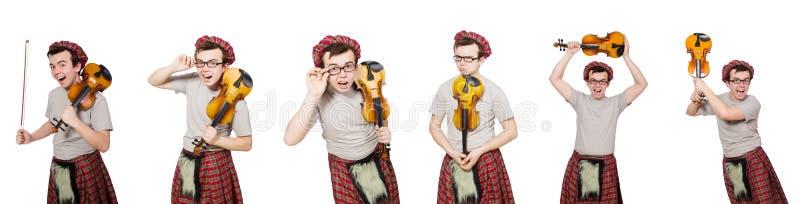 El scotsman divertido con el violín en blanco fotos de archivo libres de regalías