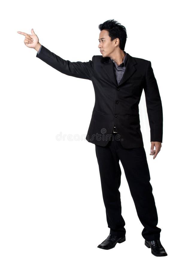El señalar de la postura del hombre de negocios aislado fotografía de archivo libre de regalías