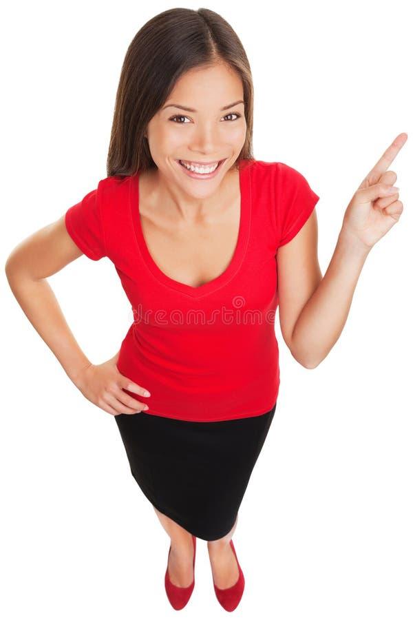 El señalar mostrando la sonrisa de la mujer alegre imagenes de archivo