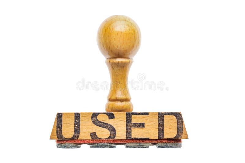 El sello de goma de la matriz con la palabra UTILIZÓ cerca encima de aislado en blanco foto de archivo libre de regalías