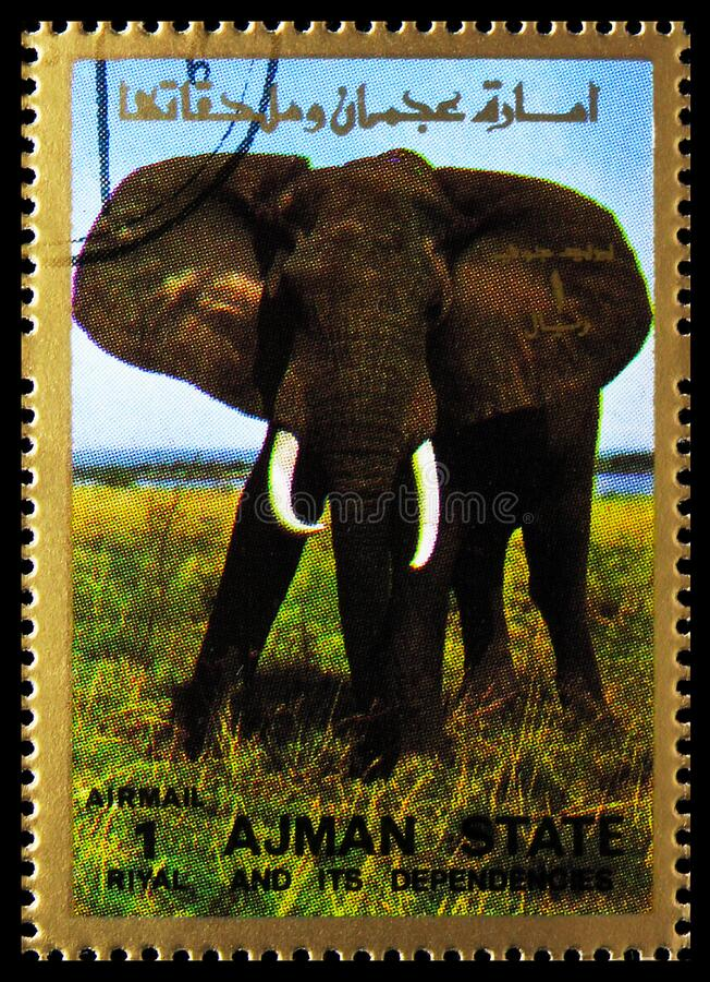 El sello de la imagen impresa en Ajman (Emiratos Árabes Unidos) muestra elefante africano (Loxodonta africana), mamíferos, serie  imagen de archivo