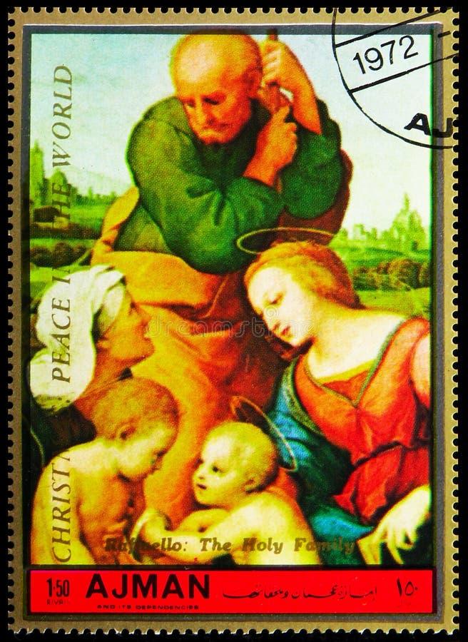 El sello de la imagen impresa en Ajman (Emiratos Árabes Unidos) muestra la Sagrada Familia; por Raphael, Navidad 1972 - Pintings  imágenes de archivo libres de regalías