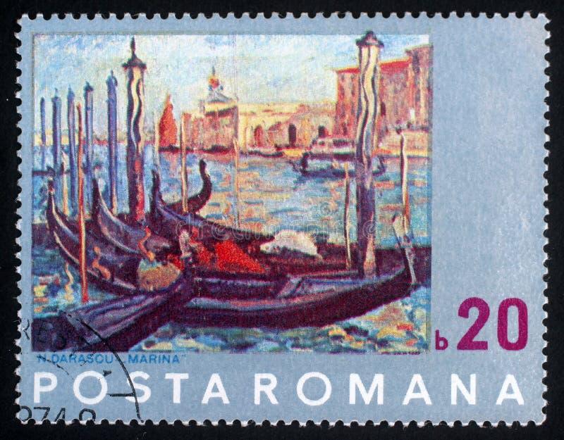 El sello de Rumania muestra la pintura de Venecia por N Darascu fotos de archivo