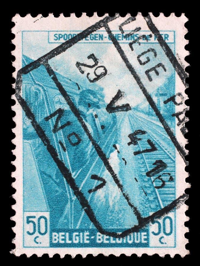 El sello impreso en Bélgica muestra el conductor de motor fotos de archivo