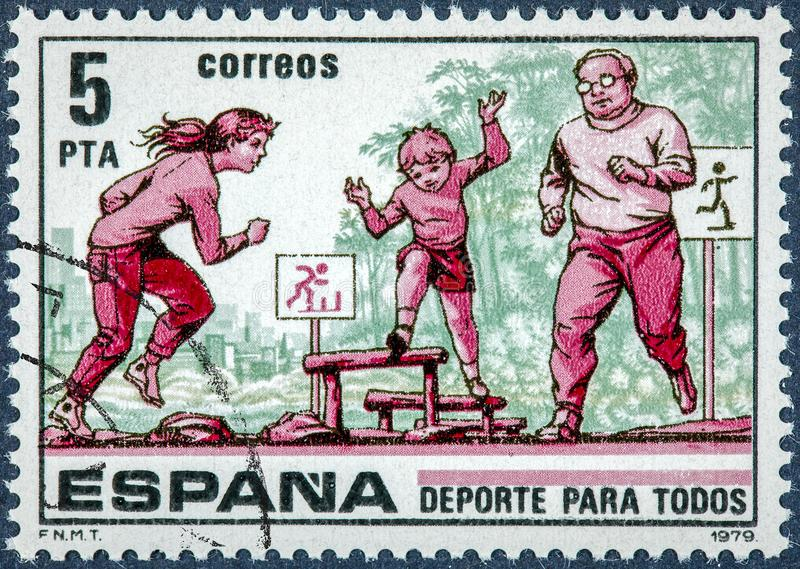 El sello impreso en España muestra el deporte para todos imagen de archivo libre de regalías