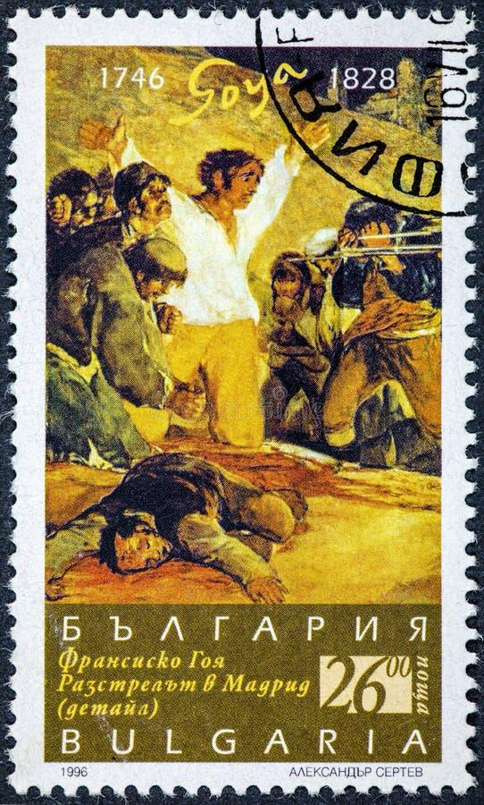 El sello impreso por las demostraciones de Bualgaria representa el tiroteo del 2 de mayo pintado por Goya fotografía de archivo libre de regalías