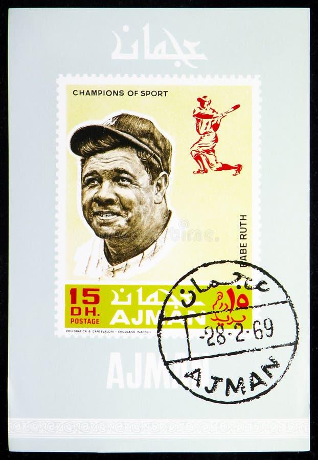 El sello postal impreso en Ajman (Emiratos Árabes Unidos) muestra Block: Babe Ruth (1895-1948), jugador profesional de béisbol am fotos de archivo libres de regalías