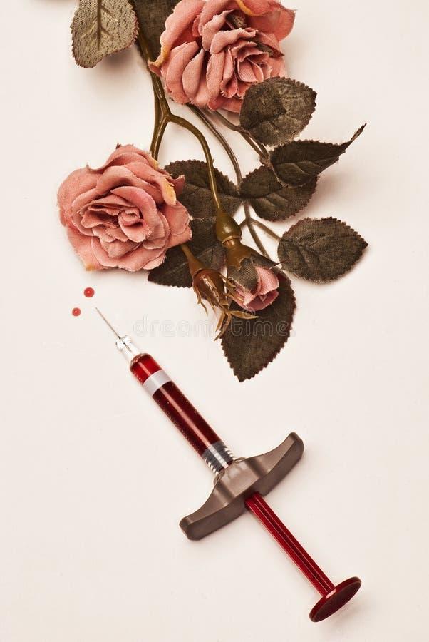 El seringe y las rosas imágenes de archivo libres de regalías