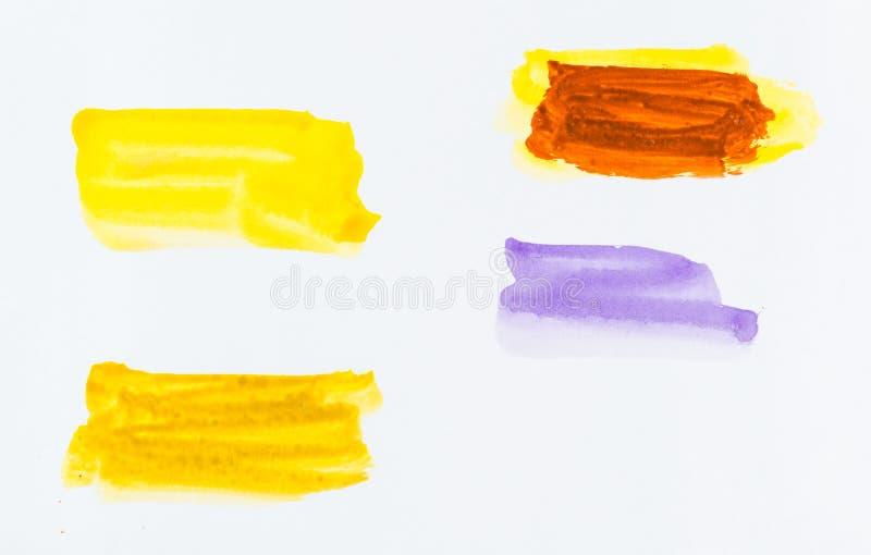 El sistema del cepillo colorido de la acuarela frota ligeramente la pintura en el backgro blanco imagen de archivo libre de regalías
