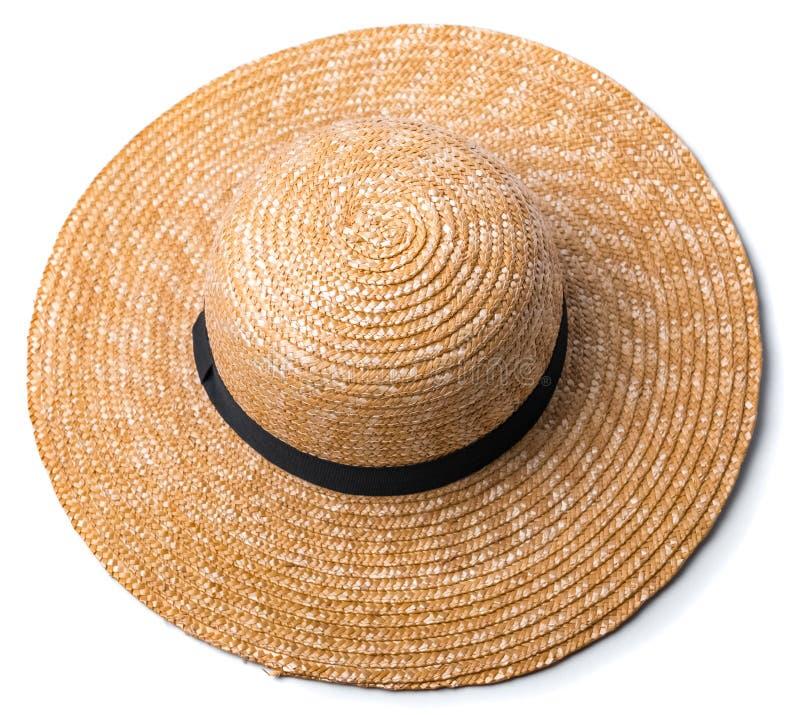 El sombrero de paja bonito con la cinta y el arco en el fondo blanco varan la opinión superior del sombrero aislado imágenes de archivo libres de regalías