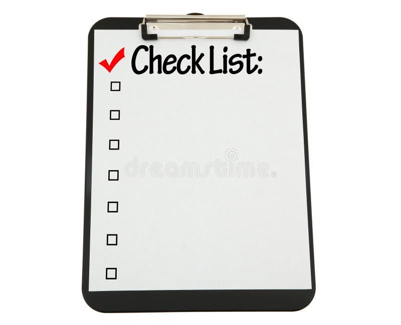 El sujetapapeles negro con la lista de verificación asoció fotos de archivo libres de regalías