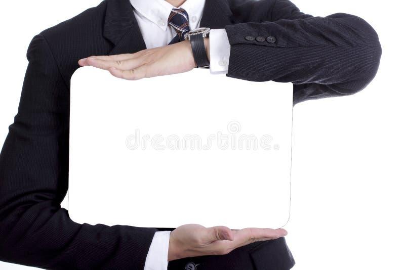 El tablero blanco de la demostración del hombre de negocios para su añade masaje imagen de archivo