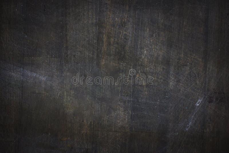 El tablero de tiza negro gris oscuro texturizó el fondo pintado foto de archivo