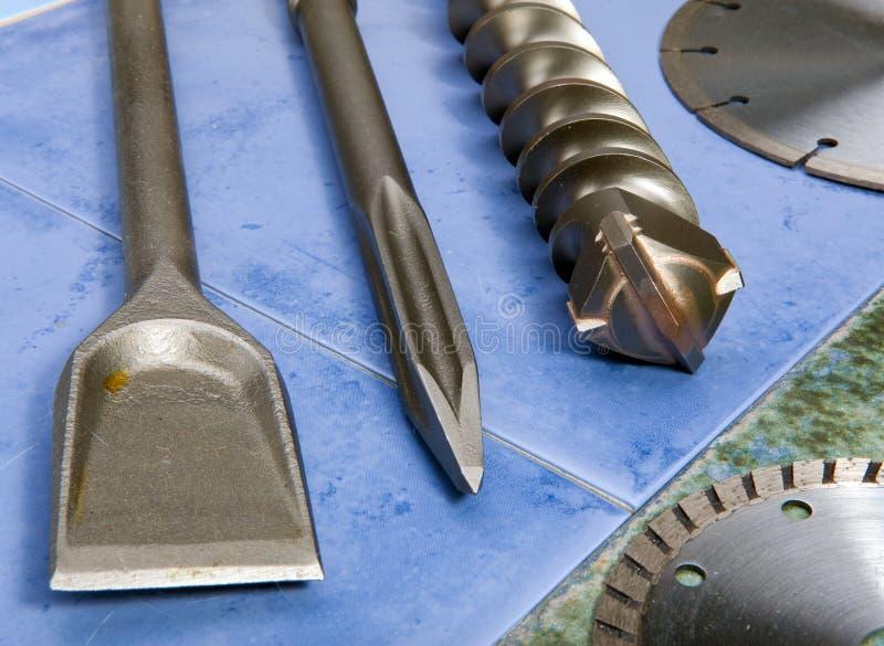 El taladro, pica, cuchilla - un sistema de las bocas para el puncher. Aún-vida fotografía de archivo