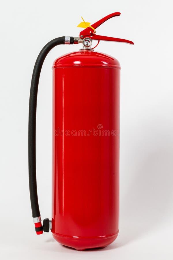 El tanque rojo químico del extintor aislado en el backgroun blanco fotografía de archivo