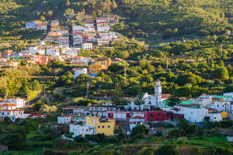 El Tanque town, Tenerife. El Tanque town on hill slope in sunset light, Tenerife island, Spain stock images