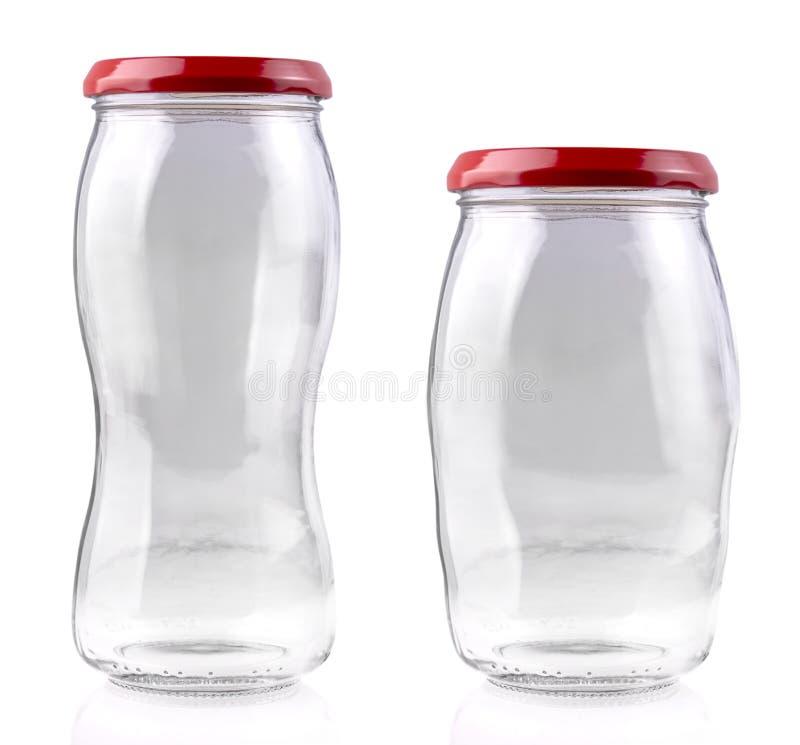 El tarro de cristal vac?o aislado en blanco con la trayectoria de recortes imagen de archivo libre de regalías