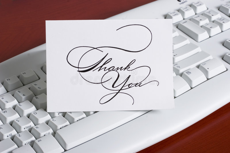 El teclado con le agradece cardar foto de archivo