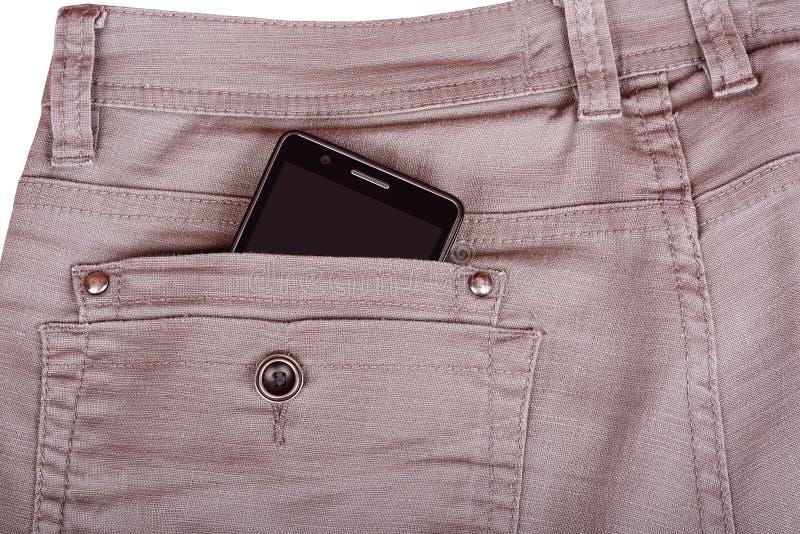 El teléfono móvil en pantalones apoya el bolsillo imagen de archivo libre de regalías
