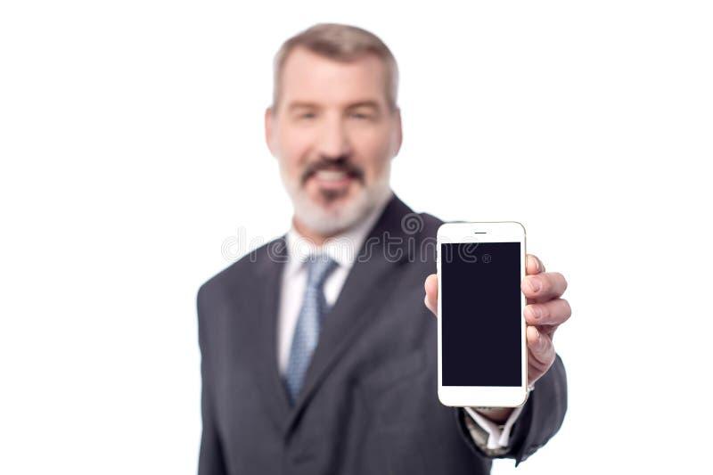 ¡El teléfono móvil a estrenar ahora está hacia fuera para la venta, compra! fotos de archivo libres de regalías