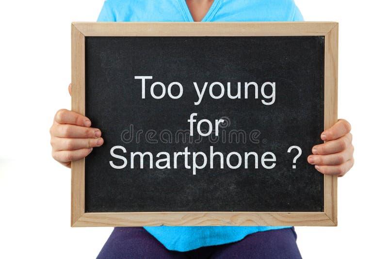El tema de cuándo dar a sus niños smartphones fotografía de archivo