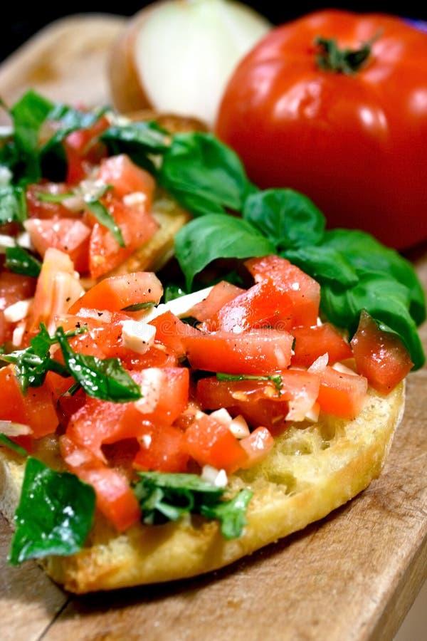El tomate remató bruschetta imágenes de archivo libres de regalías