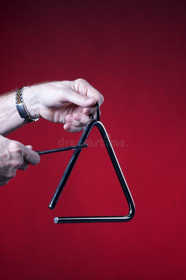 El triángulo jugó aislado en rojo foto de archivo libre de regalías