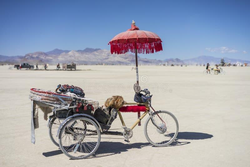 El triciclo de la hornilla en el hombre ardiente 2015 fotos de archivo libres de regalías