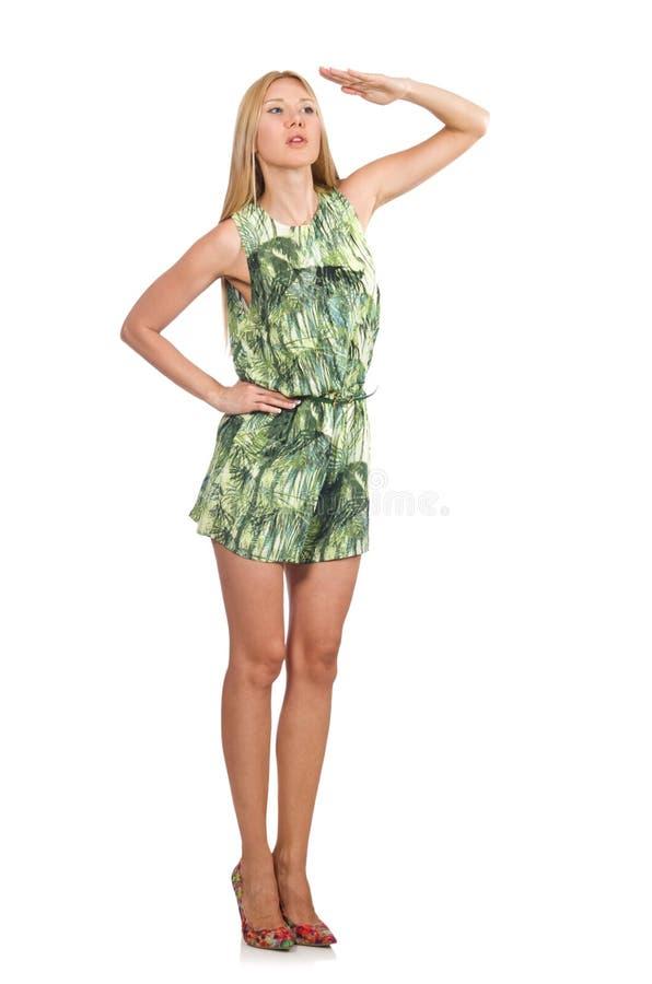 El vestido del cortocircuito del verde de la mujer del pelo que lleva rubio aislado en blanco fotografía de archivo