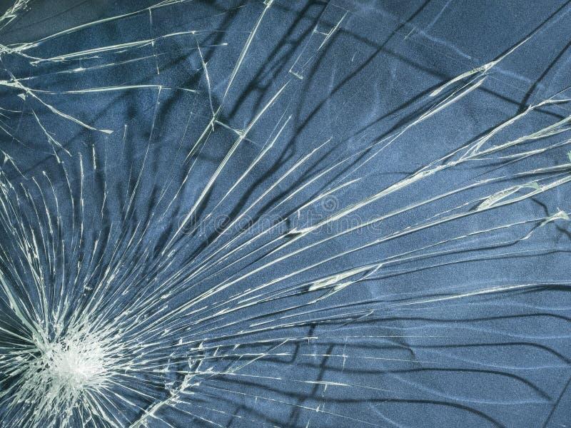 El vidrio quebrado La textura de las grietas imagenes de archivo