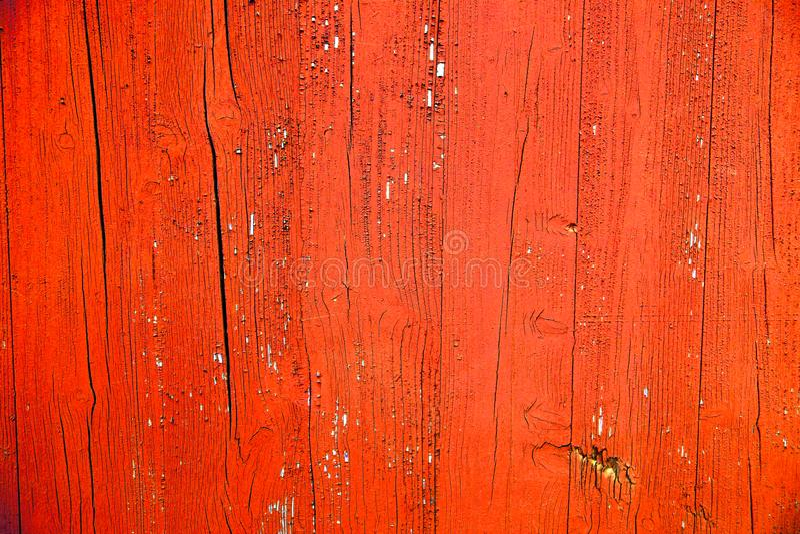 El viejo rojo sucio y resistido y la naranja pintaron el fondo de madera de la textura del tablón de la pared fotografía de archivo libre de regalías