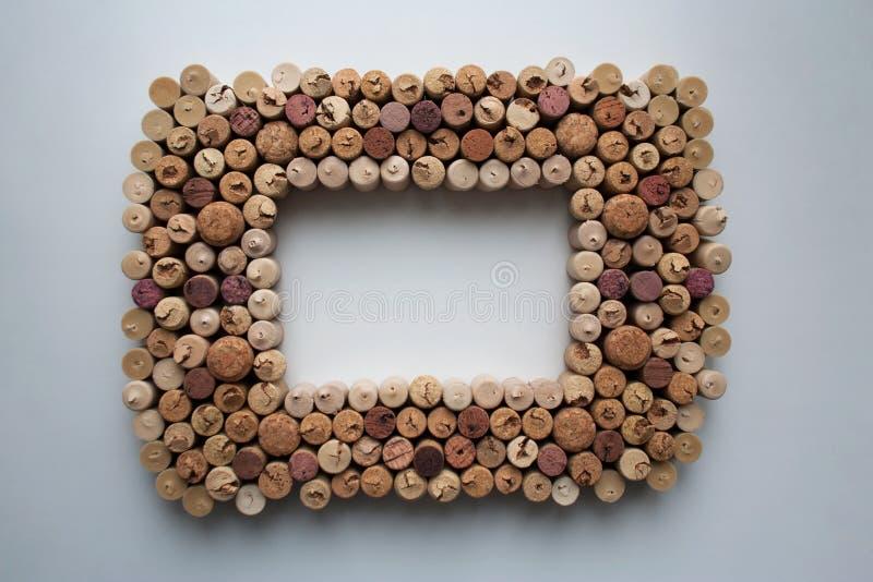 El vino tapa el marco con corcho texturizado fotografía de archivo