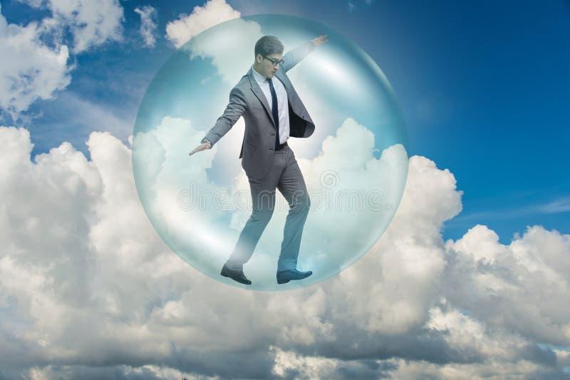 El vuelo del hombre de negocios dentro de la burbuja foto de archivo