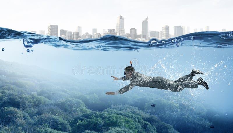 El zambullirse en hombre de negocios del agua Técnicas mixtas imagen de archivo libre de regalías