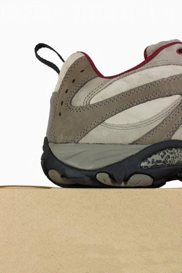 El Zapato Cercano Para Arriba De Cura En Un Rectángulo De Zapato Fotografía de archivo