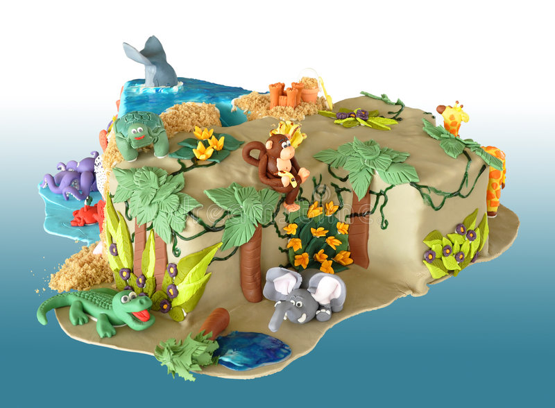 Elaborate birthday cake. Birthday cake, shaped like the number four, decorated with edible animals from the jungle and the sea stock images