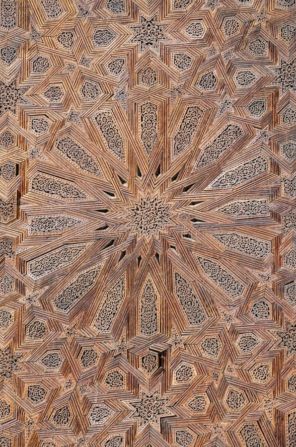 Elaborate star texture pattern on wooden door of mosque in Fez, Morocco, North Africa stock images
