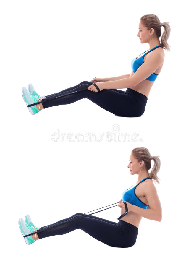 Elastic band seated row. Elastic band exercises executed with a professional trainer stock photography