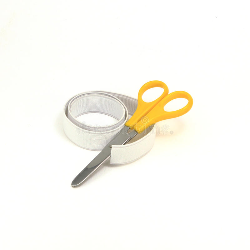 Elastic strips for cloth with scissor stock images