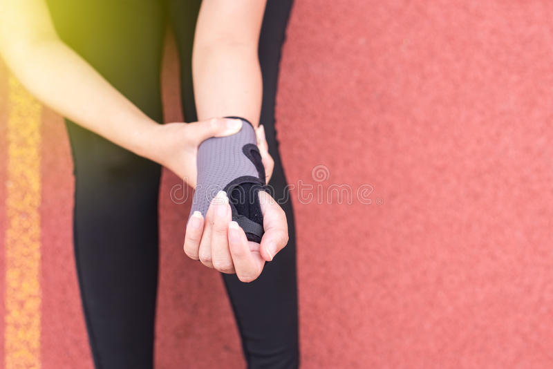 Elastic wrist support on hand to relieve pain royalty free stock images