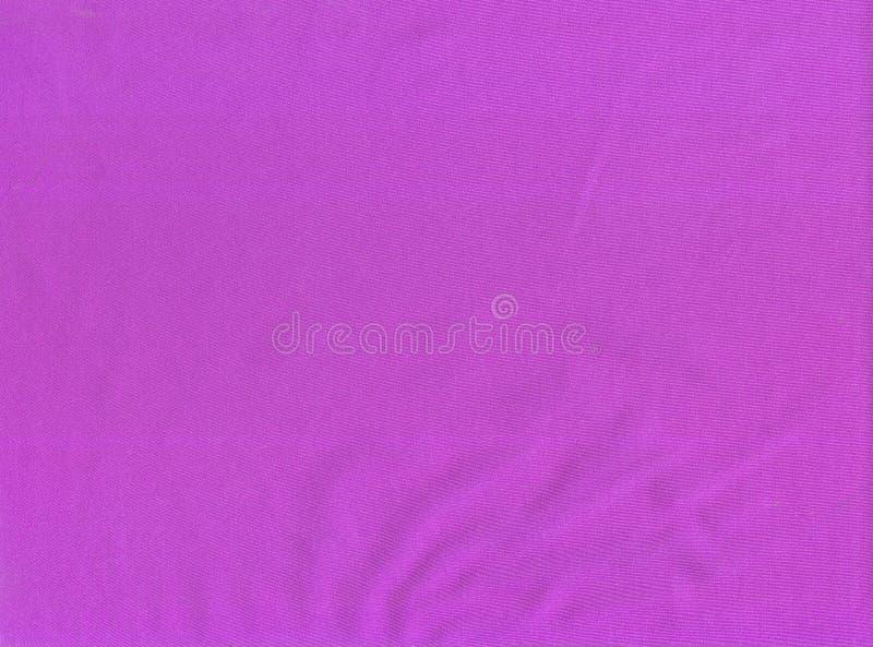 Elastisches supplex Gewebe der Beschaffenheit Säure-rosa lizenzfreie stockbilder